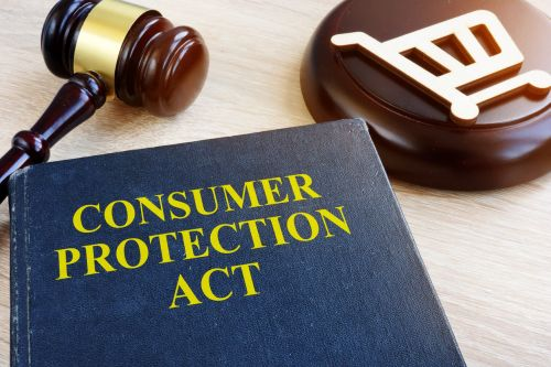 Consumer protection act and gavel on a table.