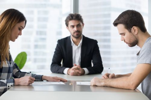 lawyer overseeing couple divorce mediation