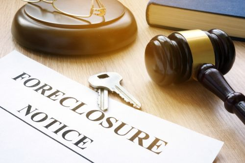 Foreclosure notice with judge's gavel to stop foreclosure